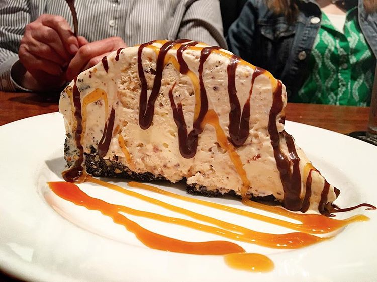 Caramel Nut Crunch Pie: Crushed Snickers® candy bar pieces mixed with premium vanilla ice cream. Served in an Oreo® and peanut crust. Topped with warm caramel and fudge sauces.